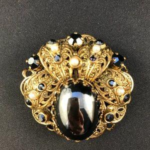 Vintage gold and black brooch
